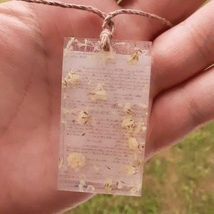 Floral writing pendant necklace